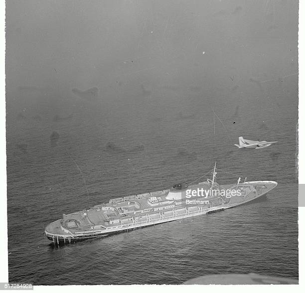 Life boats still remain on her port side as the Italian liner Andrea Doria lies dead in the water her crew and passengers abandon after a collision...