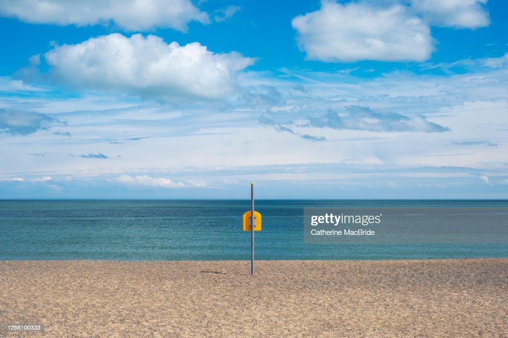 Life Bouy on empty beach on Irelands East Coast : Stock Photo