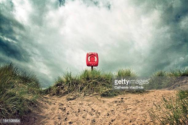 Life buoy and stormy clouds