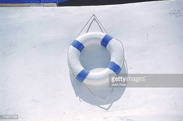 Life buoy hanging on wall, close-up