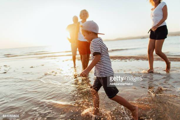 life by the ocean - candid beach stock photos and pictures