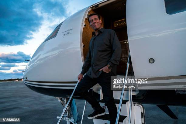 Life coach and business guru Tony Robbins is photographed for Money Magazine on March 17 at his home in Palm Beach, Florida. Robbins poses in front...