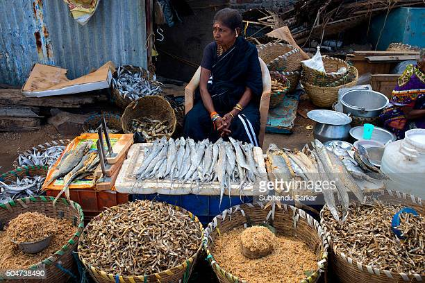 Life gets back to normalcy in Chennai after heavy floods as a woman sells dried fish are on sale Kasimedu fishing harbour Royapuram fishing harbour...