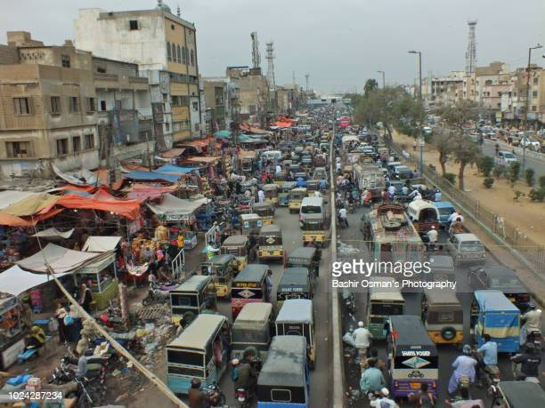 life going around streets of the city - pakistan stock pictures, royalty-free photos & images