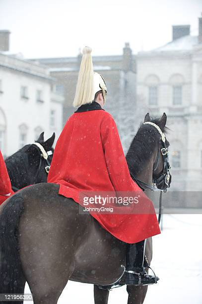 life guard on horse in the snow - household cavalry stock pictures, royalty-free photos & images