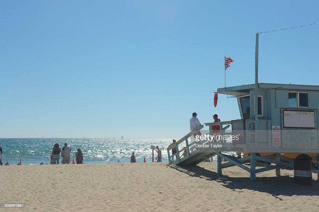 Life guards observe the scene at Santa Monica beach August 17, 2914