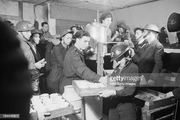 Life In A Basement Air Raid Shelter South East London England Tea and buns are supplied by local Air Raid Precautions workers to fellow ARP workers...