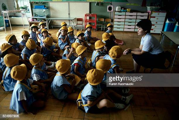 Life in an urban highrise called a Danchi Most urban Japanese live in this type of dwelling Here students attend a kindergarten class