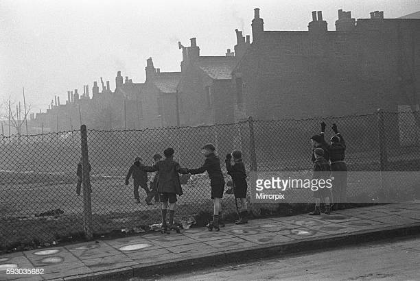 Life in the Mirror Our Gang 19th January 1954 Boys playing football watched on by others on a bomb site off Bow Road in the East End of London