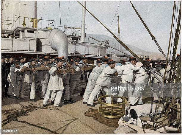 Life in the navy before use of the steam the sailors raise the anchor illustration from a military album 1915