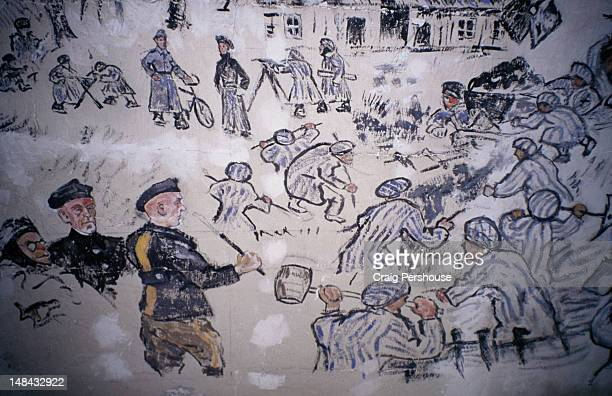 life inside a nazi concentration camp, painted by a jewish inmate on the wall of one of the prison barracks in birkenau. - auschwitz concentration camp stock pictures, royalty-free photos & images