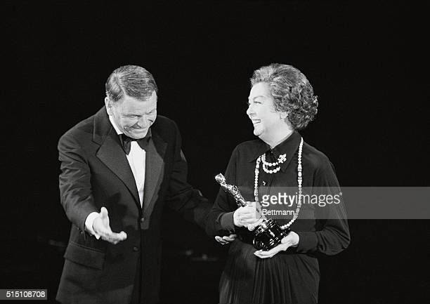 Life is a Banquet Hollywood Frank Sinatra greets Rosalind Russell as he presents the Jean Hersholt Humanitarian Award to her at the 1973 Academy...