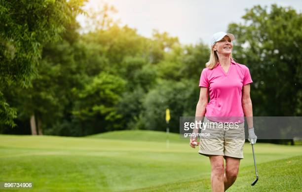 life is good when you playing golf - one mature woman only stock pictures, royalty-free photos & images