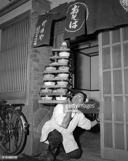 Life is just a bowl of noodles to the champion noodle delivery man in Tokyo, Senichi Okashita, by name. He recently won the first prize in the...