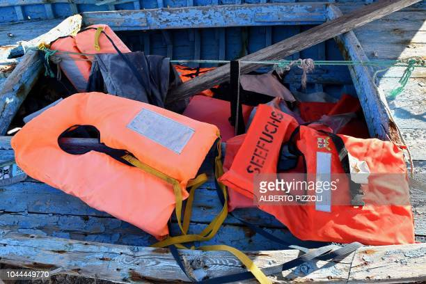 A life jacket from German NGO Seefuchs is pictured in the socalled boat cemetery where skiffs are dumped after the migrants and refugees' crossing...