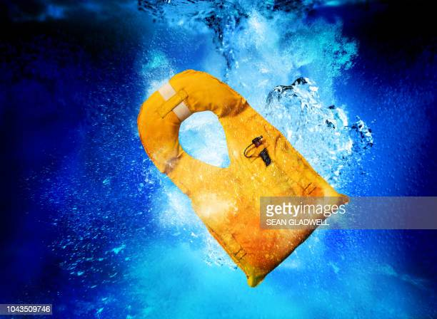 life jacket sinking - life jacket stock pictures, royalty-free photos & images
