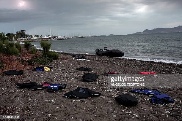 Life jackets are seen on a beach on the Greek island of Kos after Afghan migrants arrived after crossing a part of the Aegean Sea between Turkey and...