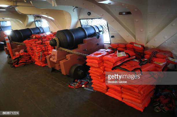 Life jackets are stacked near the cannons for spectators on board as the USS Constitution makes a voyage across Boston Harbor on Oct 20 after being...