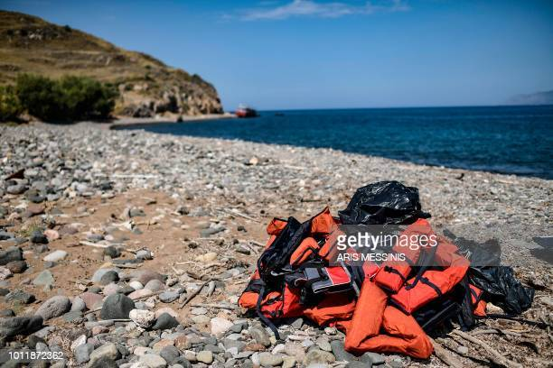 Life jackets that were used by migrants are seen on a beach on the Greek Mediterranean island of Lesbos on August 6 2018 More than 1500 refugees and...