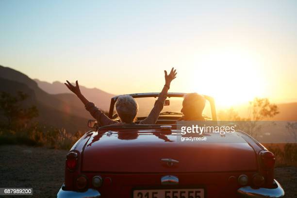 life! let's live it! - convertible stock pictures, royalty-free photos & images