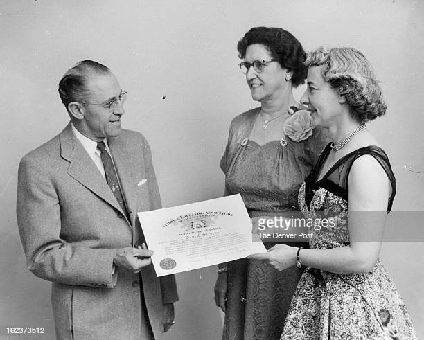 JAN 1 1954 A life membership in the National Education Assn is presented Paul C Stevens resigned superintendent of Jefferson county schools by Miss...