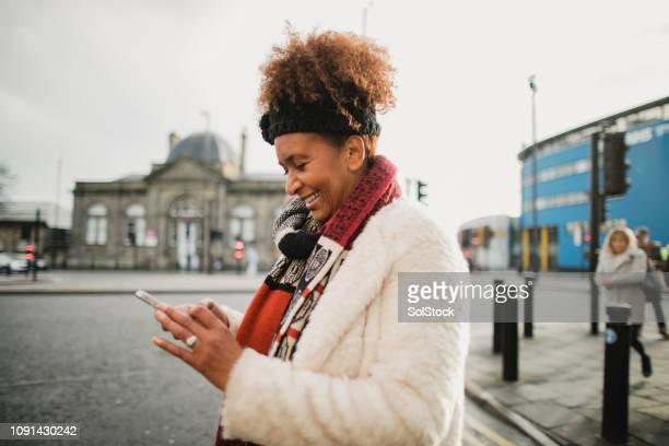 life of a mature woman in the city - warm clothing stock pictures, royalty-free photos & images