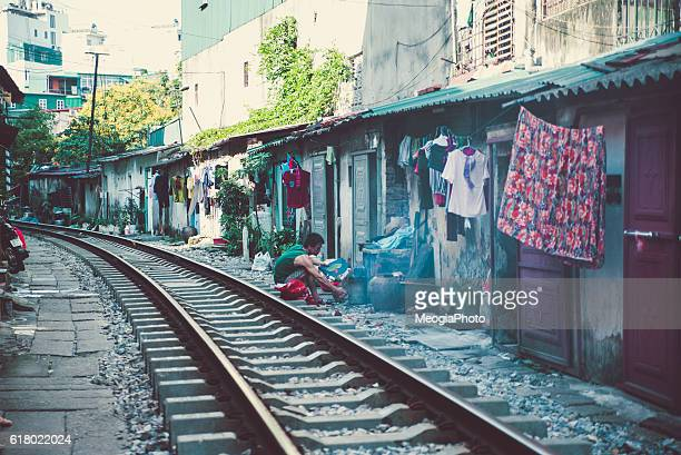 life of people who live near the railway in hanoi ancient town. - poor service delivery stock pictures, royalty-free photos & images