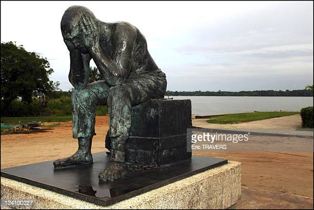 Life on the Maroni river In French Guiana On August 19 2002 Statue of a chained convict on a square of St Laurent du Maroni not far from the Camp of...