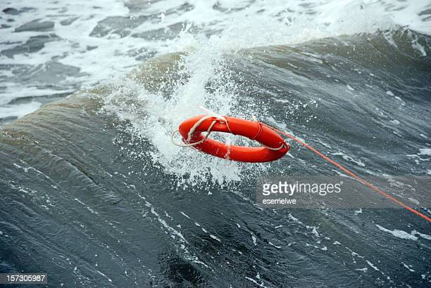 A life preserver being thrown into the water
