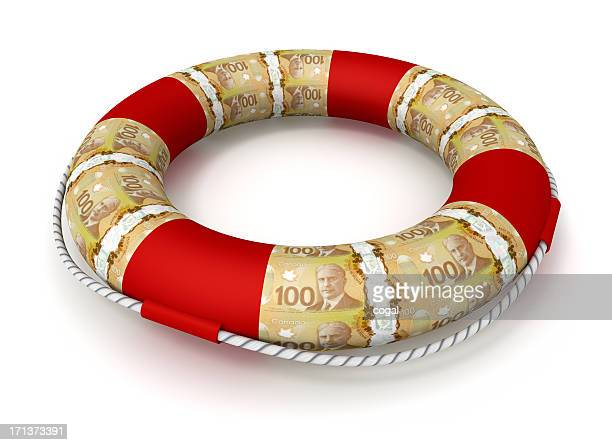 life preserver covered by canadian dollars - canadian one hundred dollar bill stock pictures, royalty-free photos & images
