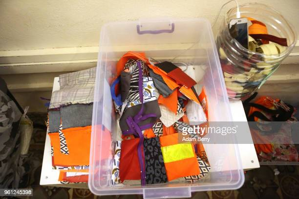 Life preserver fabric is mixed with other types of material to be sewn into bags at the Lesvos Solidarity organization's Safe Passage Bags workshop...