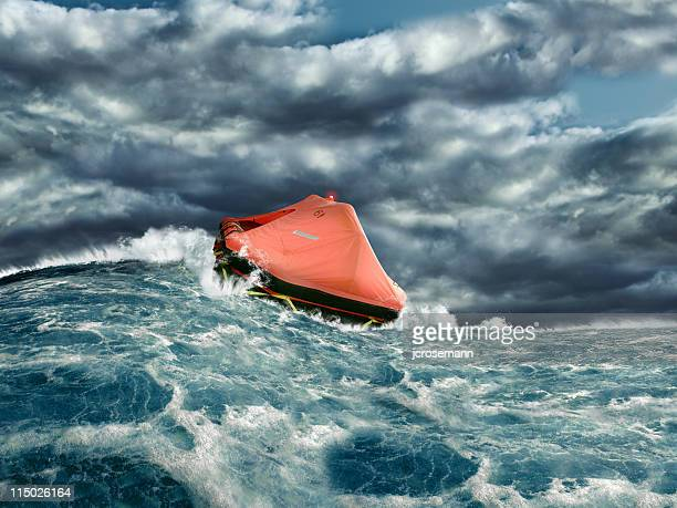 life raft in stormy ocean - rescue stock pictures, royalty-free photos & images