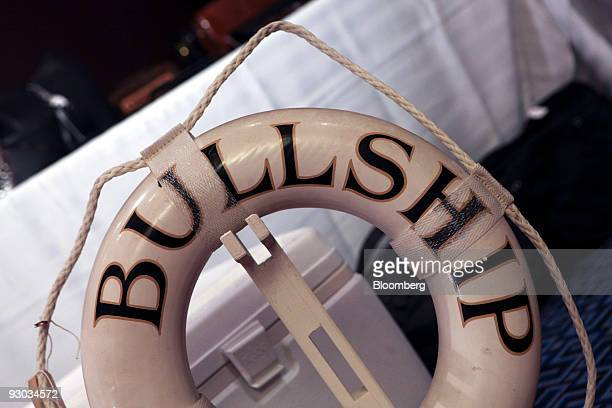 A life ring marked with the boat name Bullship is displayed during a media preview for an auction which includes jewelry and other personal items...