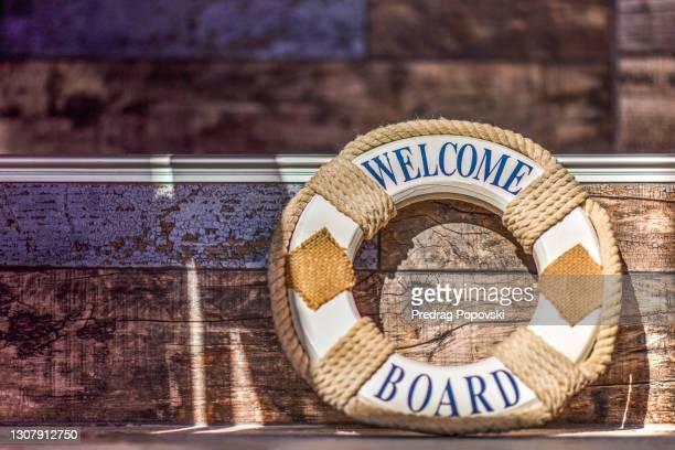 life ring on rustic wooden deck stairways - 乗り物に乗って ストックフォトと画像