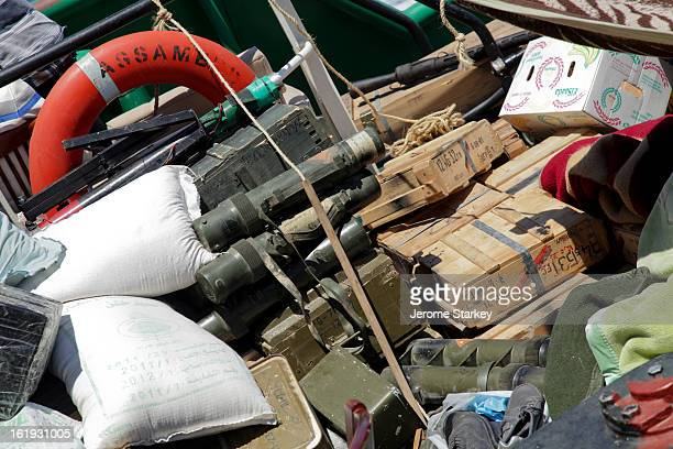 Life ring, sacks of rice, mortar tubes and various ammunition crates all piled together on the rear deck of a Libyan tug boat ferrying supplies to...