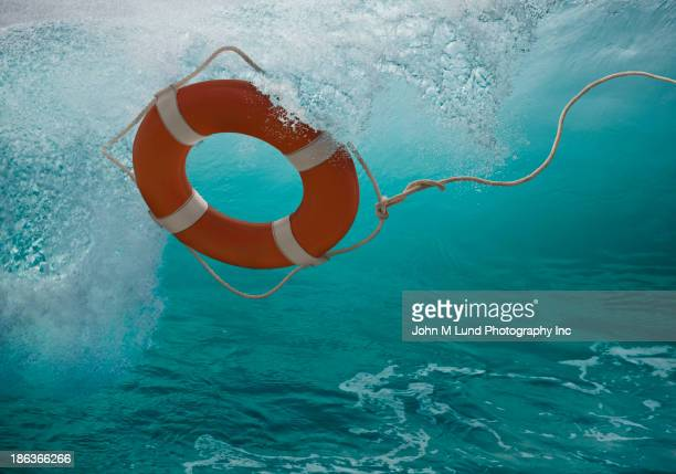 Life ring tossing in waves