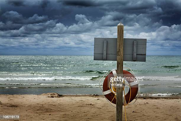 Life Saver on Beach with Dark, Stormy, Dangerous Water, Clouds