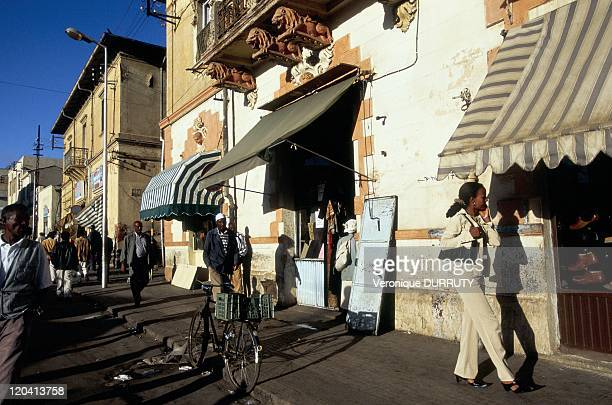 Life scene on the street of the tone of Asmara in Eritrea Asmara is the capital and largest city of Eritrea Its population is about 500000 habitants...