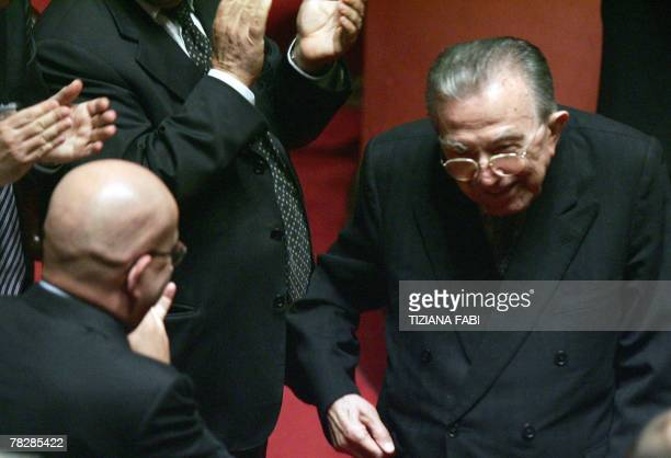Life senator and former Italian Prime Minister Giulio Andreotti receives applauses by the opposition after voting against the government on a...