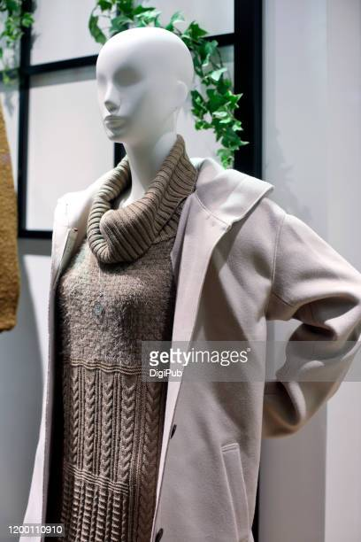 life size female like mannequin in sweater dress and coat - ニットワンピース ストックフォトと画像