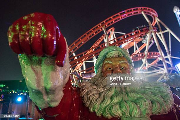 A life size figure of Father Christmas in front of a rollercoaster at the Winter Wonderland in Hyde Park on December 21 2016 in London England Winter...