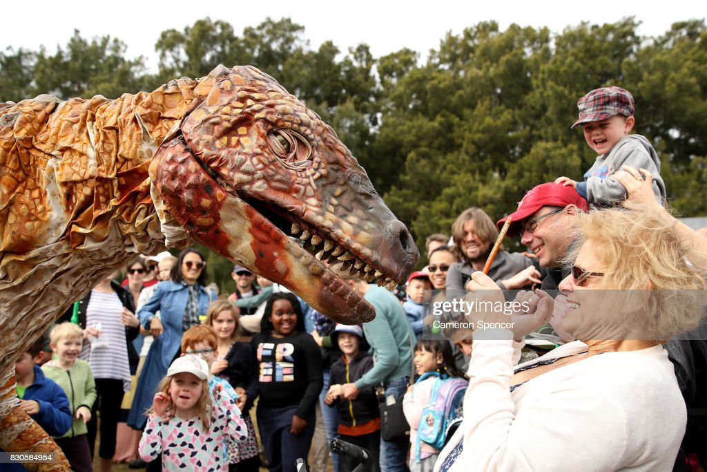 A life size roaming dinosaur walks through the parklands at Centennial Park on August 12, 2017 in Sydney, Australia. The dinosaur visit is part of 'Science by the Swamp' during National Science Week celebrations. Photo by Cameron Spencer/Getty Images)