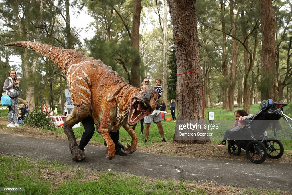 A life size roaming dinosaur walks through the parklands at Centennial Park on August 12, 2017 in Sydney, Australia. The dinosaur visit is part of 'Science by the Swamp' during National Science Week celebrations.