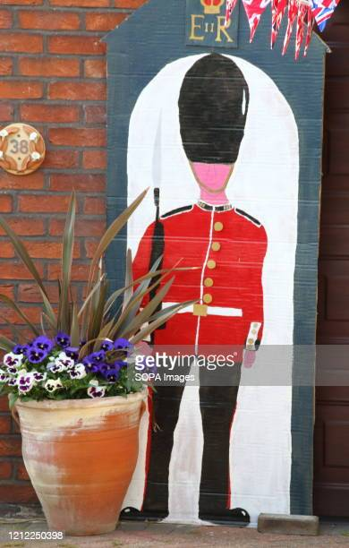 Life sized cardboard cut out figure of a soldier outside a house Union Jacks bunting and other decoration during the commemoration The VE Day 75th...