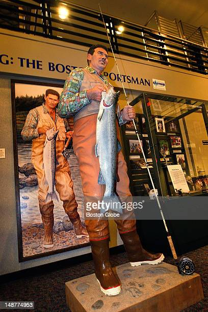 A life sized wooden sculpture of Red Sox great Ted Williams in a fishing vest and waders displaying his latest catch is part of a series of Armand...