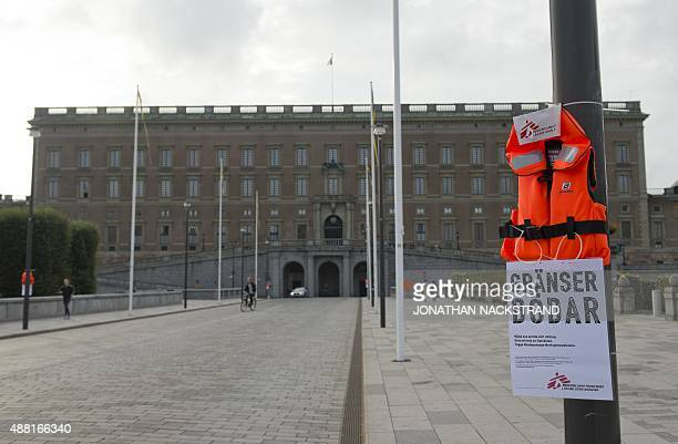 A life vest and a placard reading Borders kill hangs on the square in front of the Royal Palace in Stockholm as part of an action by Swedish branch...