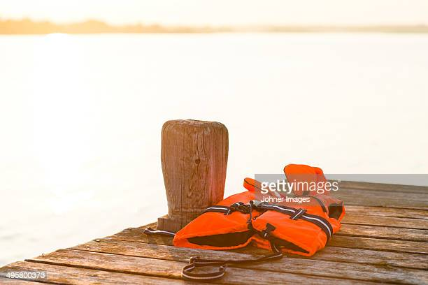 life vest on jetty, sandham, sweden - life jacket stock pictures, royalty-free photos & images
