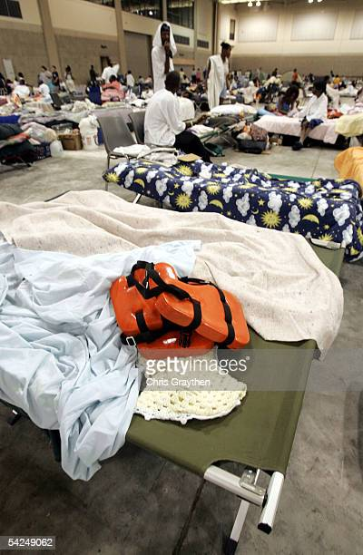 Life vest sits on a cot from a refugee from the New Orleans area who was rescued by helicopter at the Red Cross shelter at the River Center on...