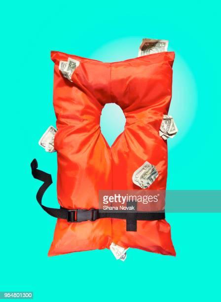 life vest stuffed with money - life jacket photos fotografías e imágenes de stock