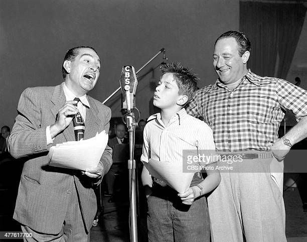Life with Luigi a CBS Radio program From left J Carrol Naish and Alan Reed Jr discussing Luigis financial affairs At right Alan Reed Sr Image dated...